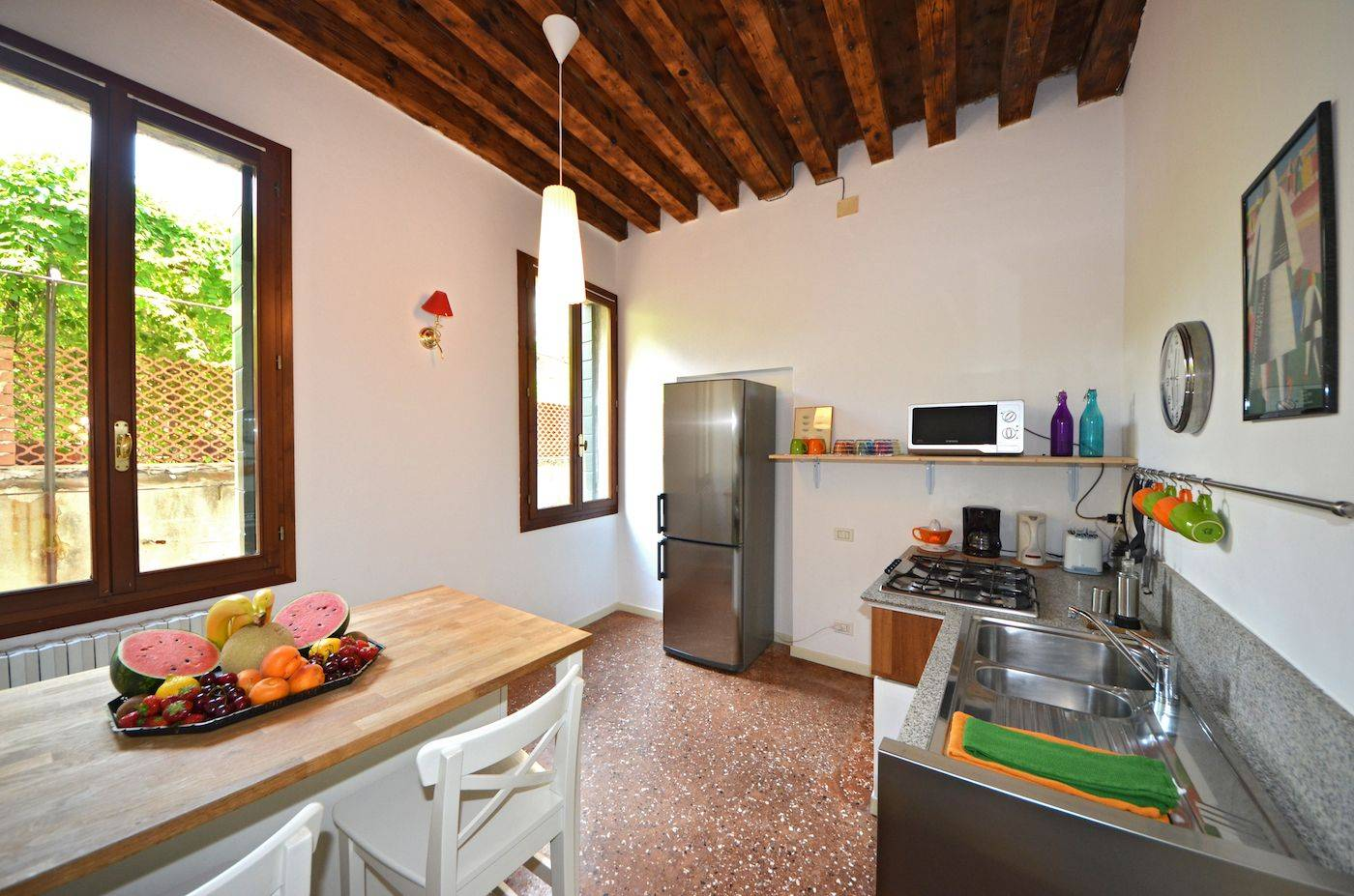 the spacious and bright kitchen with breakfast table for two