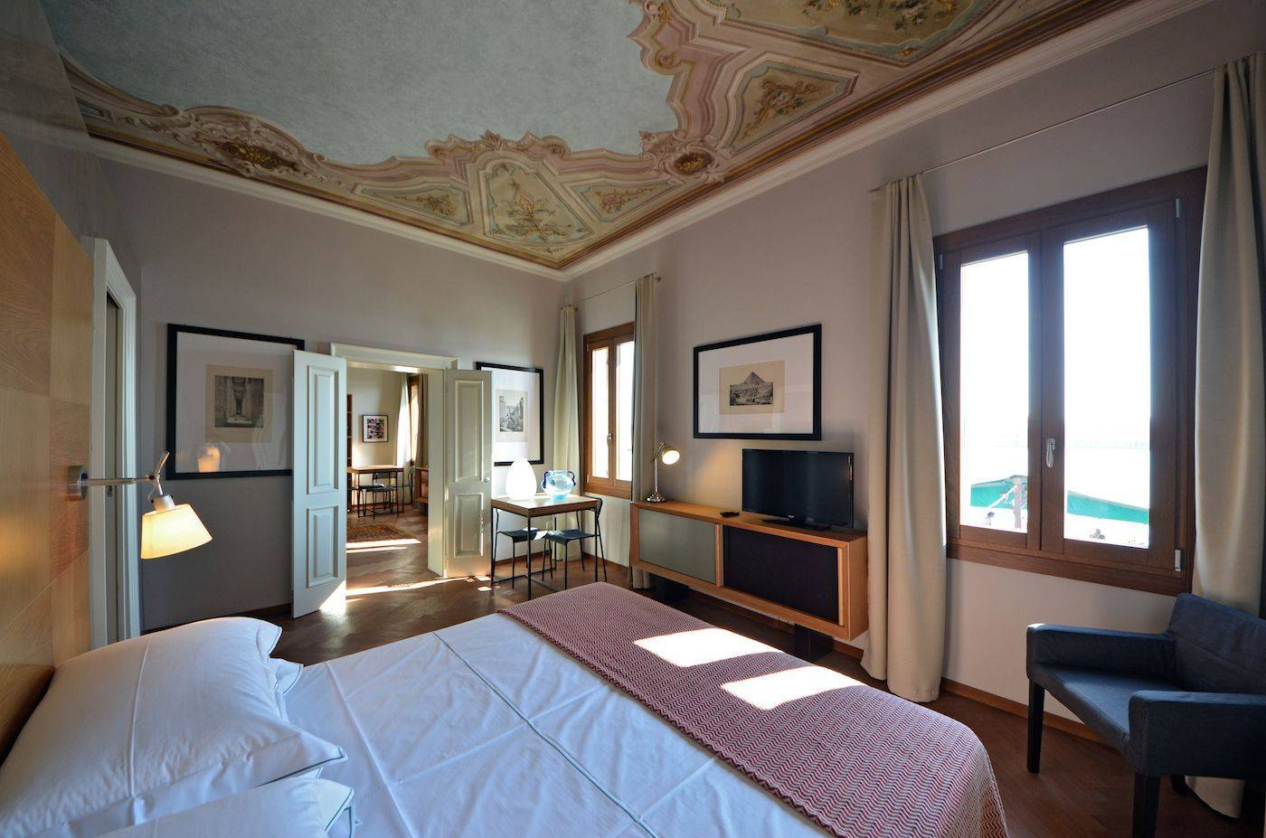 master bedroom with frescoed ceiling and canal view