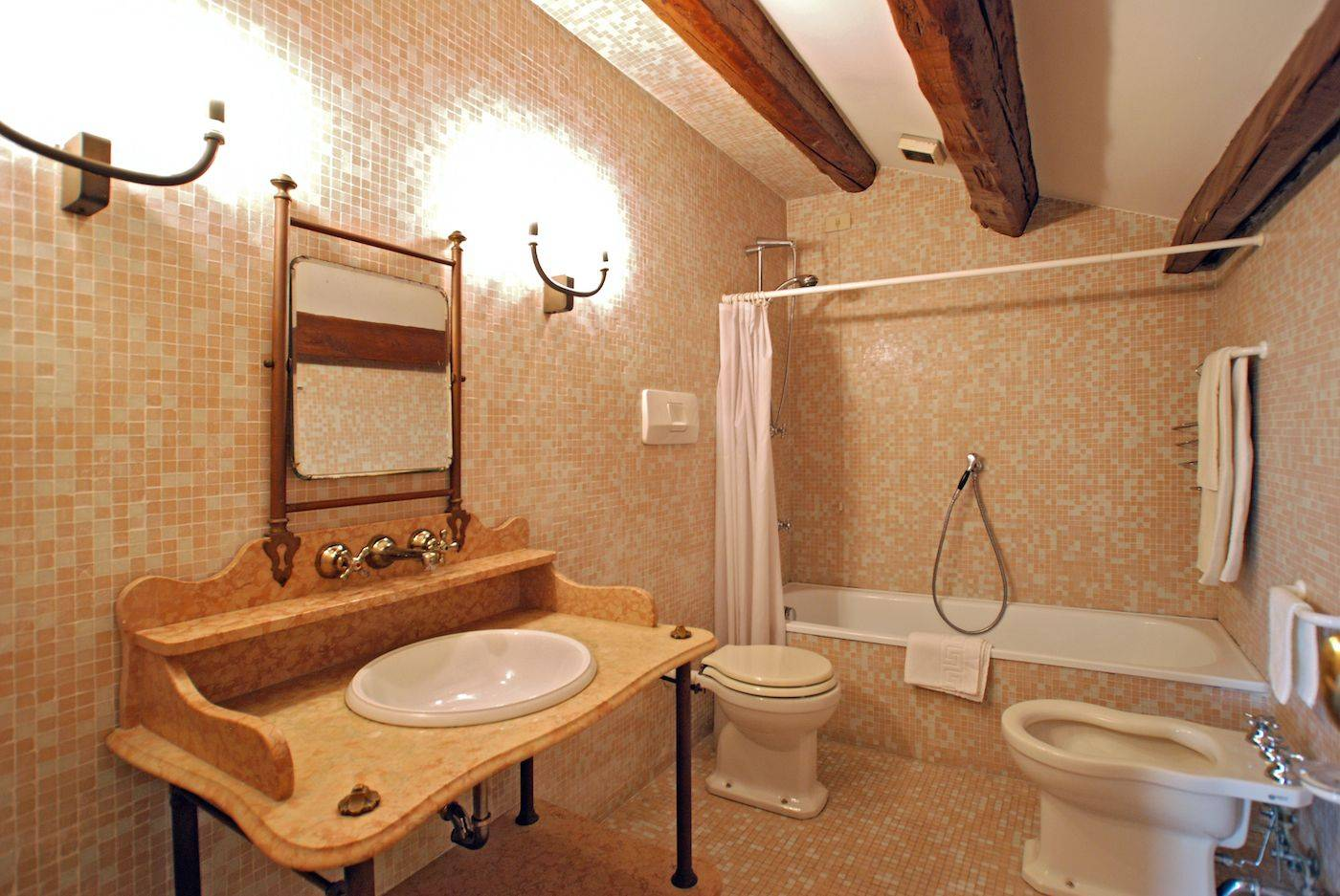 the elegant bathroom of the attic with bathtub and mosaic tiles