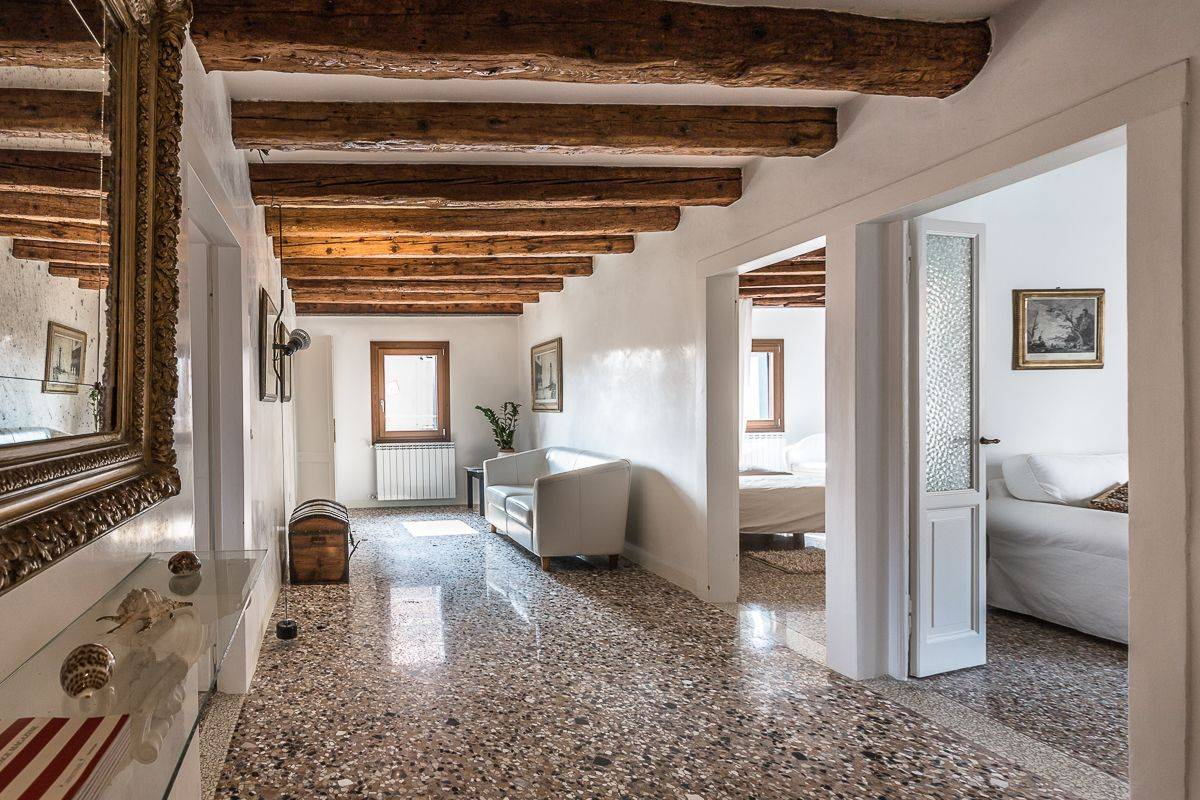 entrance hall with terrazzo flooring and wooden beams