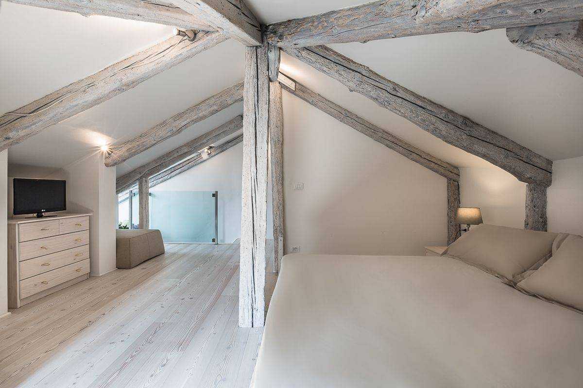 the attic is a spacious and elegant open space with bathroom and panoramic view