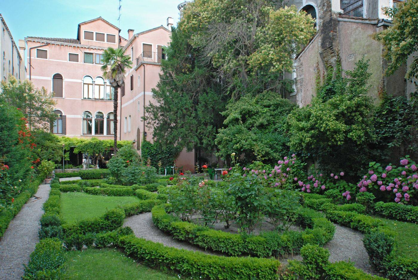 view of the elegant Italian Style private garden