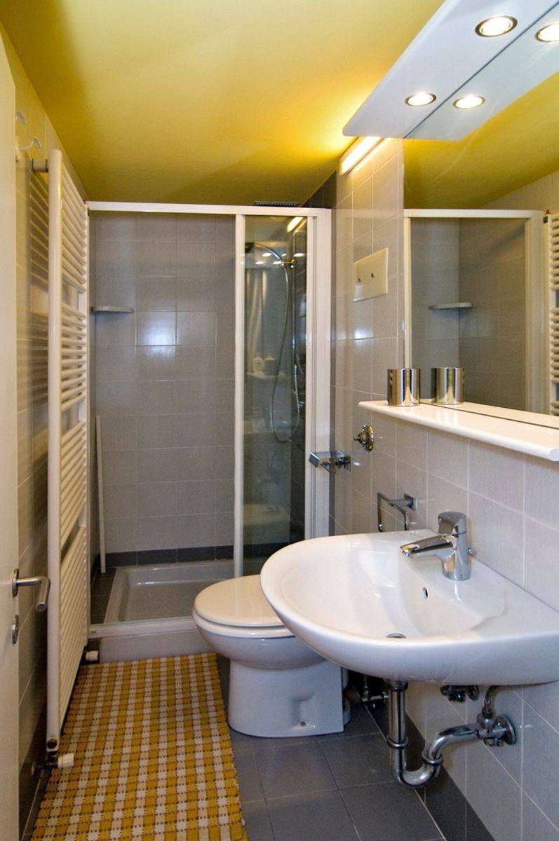 smaller bathroom with shower cabin