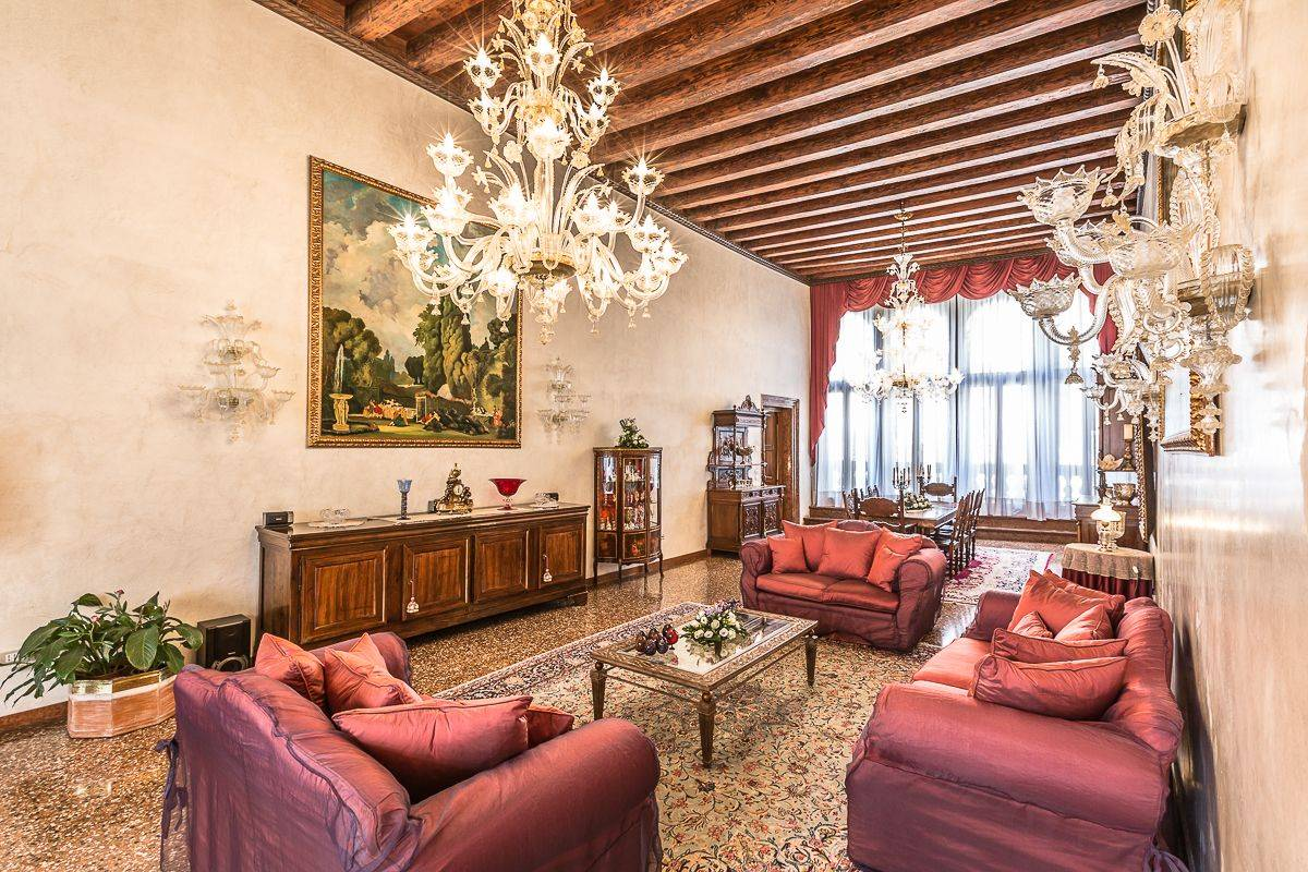 with precious Murano Glass chandeliers, antique furniture, Venetian Terazzo flooring...