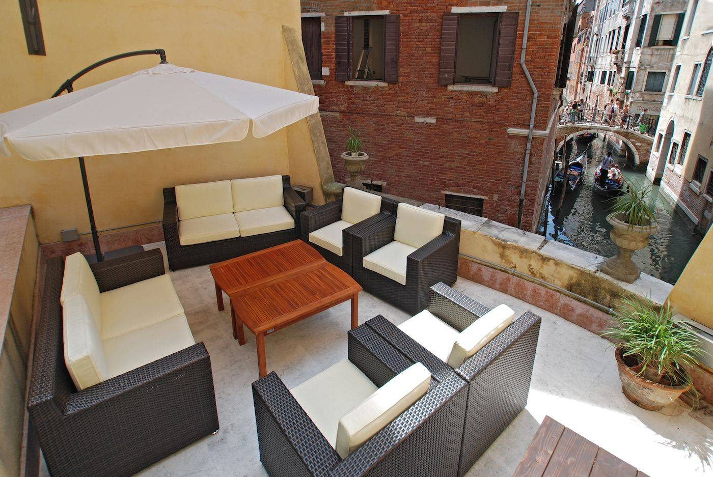 the Tommaseo apartment has a large shared terrace overlooking a canal