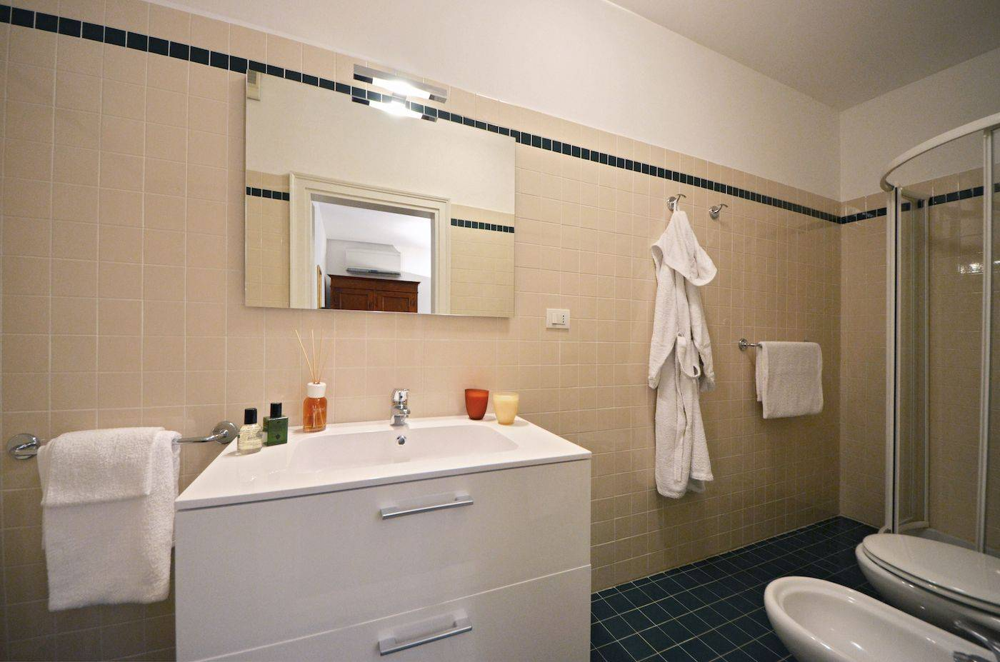 the en-suite bathroom of the second bedroom has a shower cabin