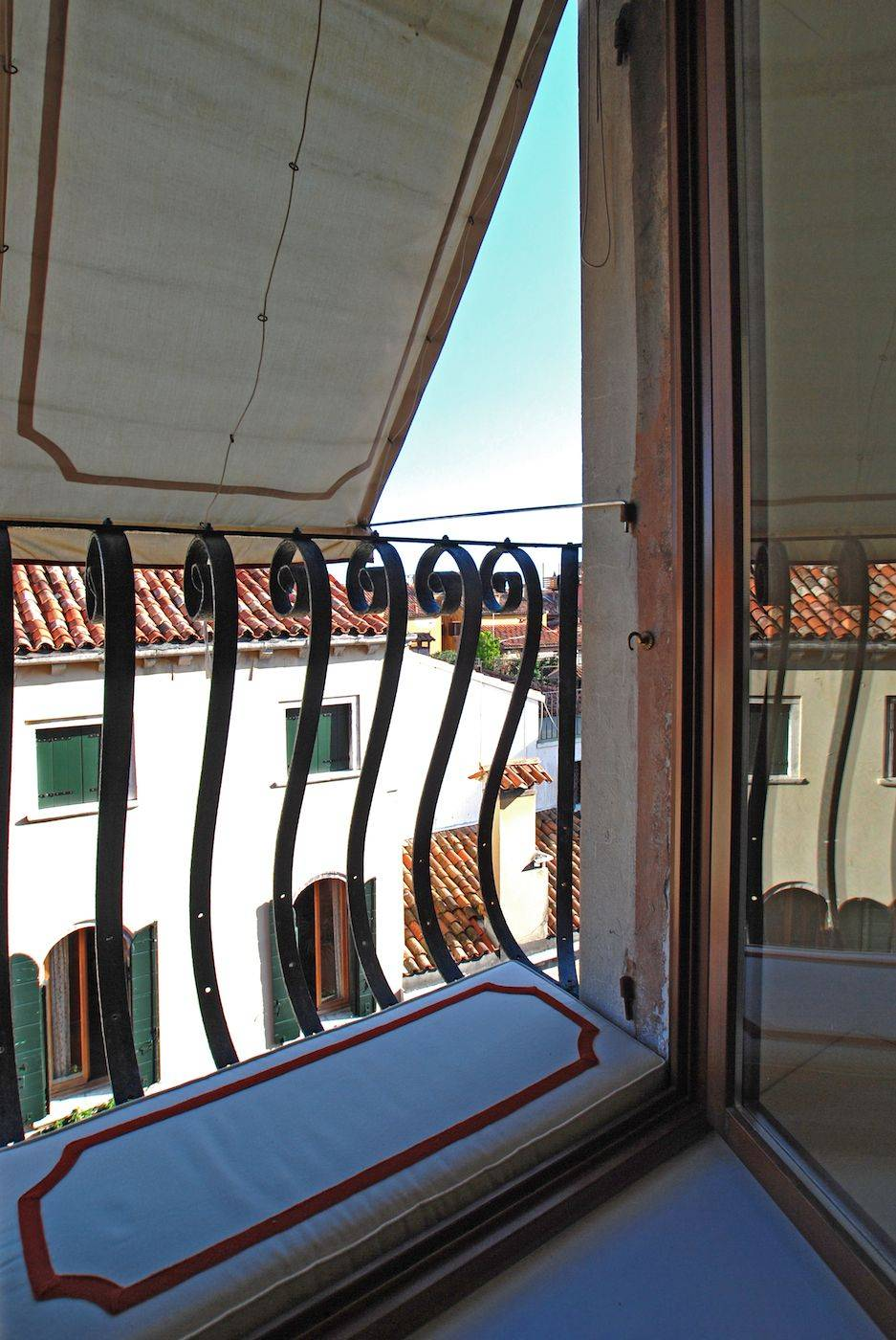 the windows of the living have a small balcony and a great view