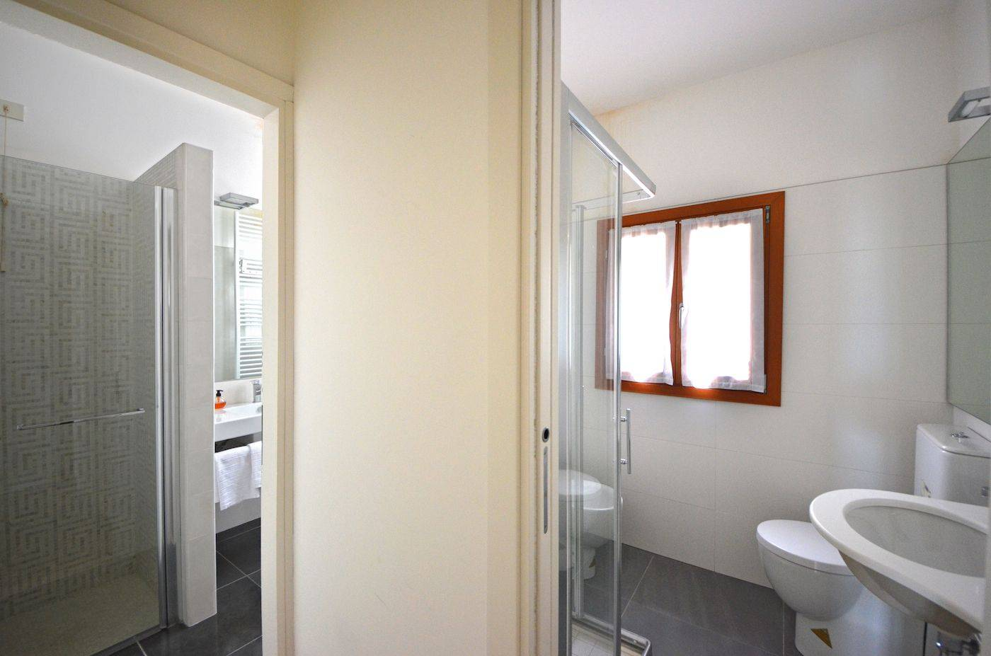 the two nice bathrooms can be accessed from the entrance room
