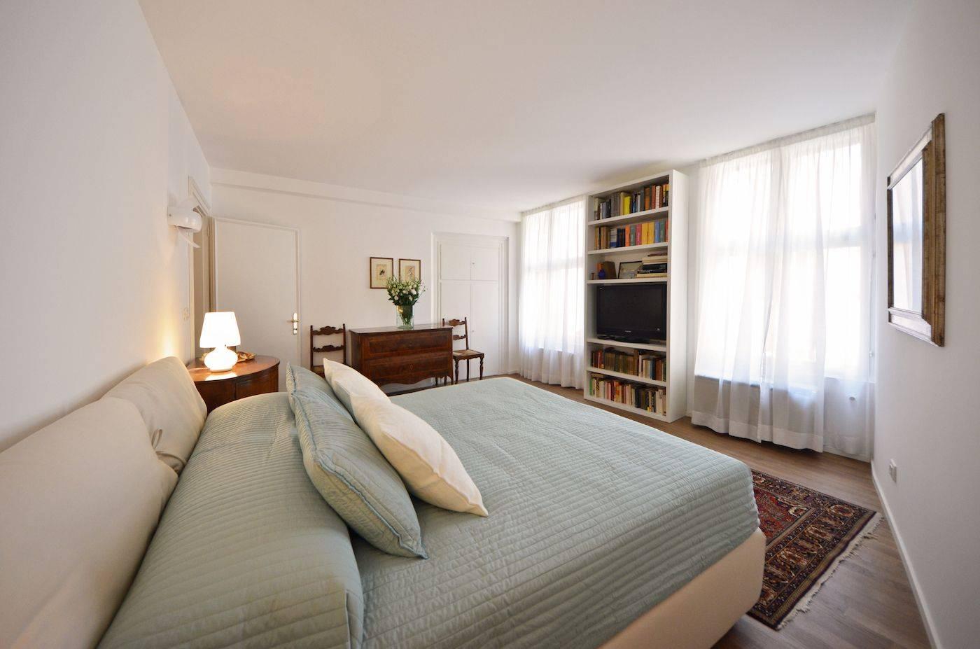 comfortambe king size mattress, parquet flooring and antique furniture