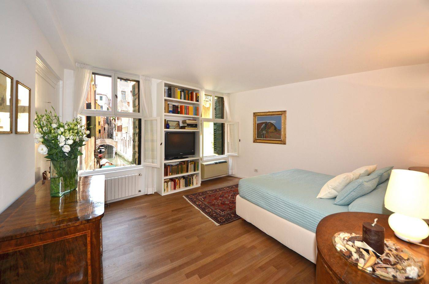 the spacious master bedroom features an incomparable canal view