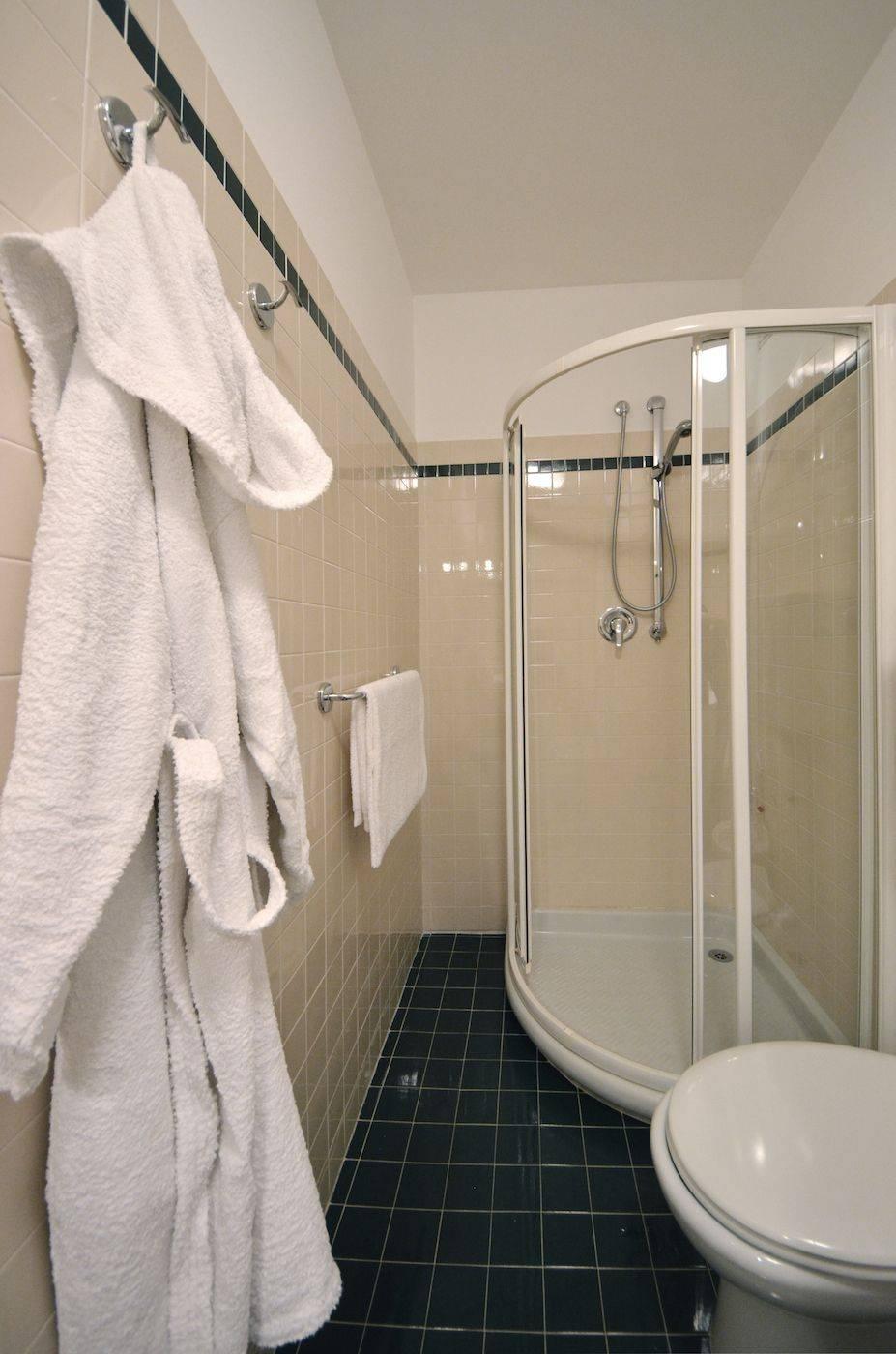the en-suite bathroom of the second bedroom has a shower cabin