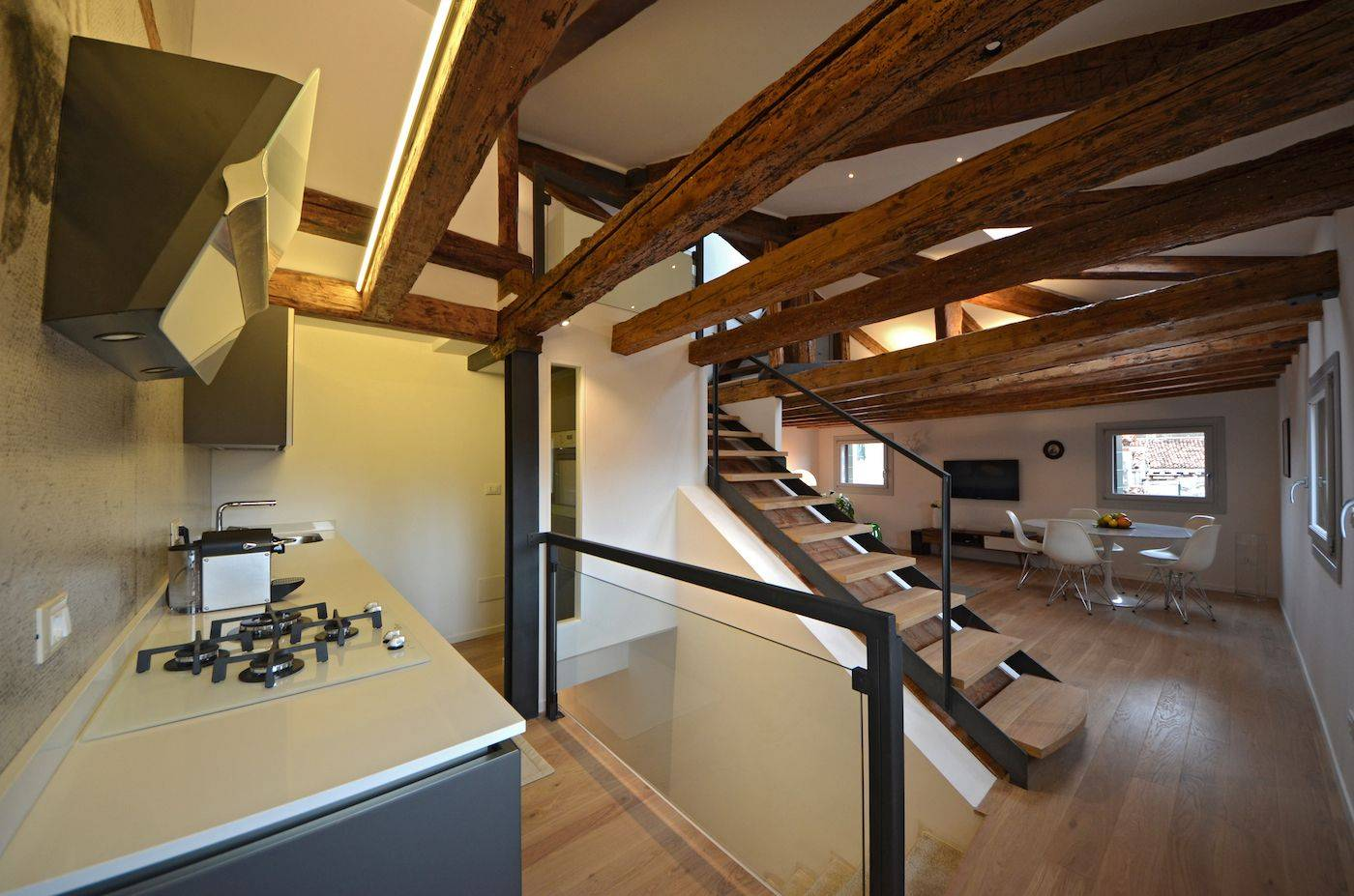between the kitchen and the living room there is an easy to climb staircase leading to the attic and terrace
