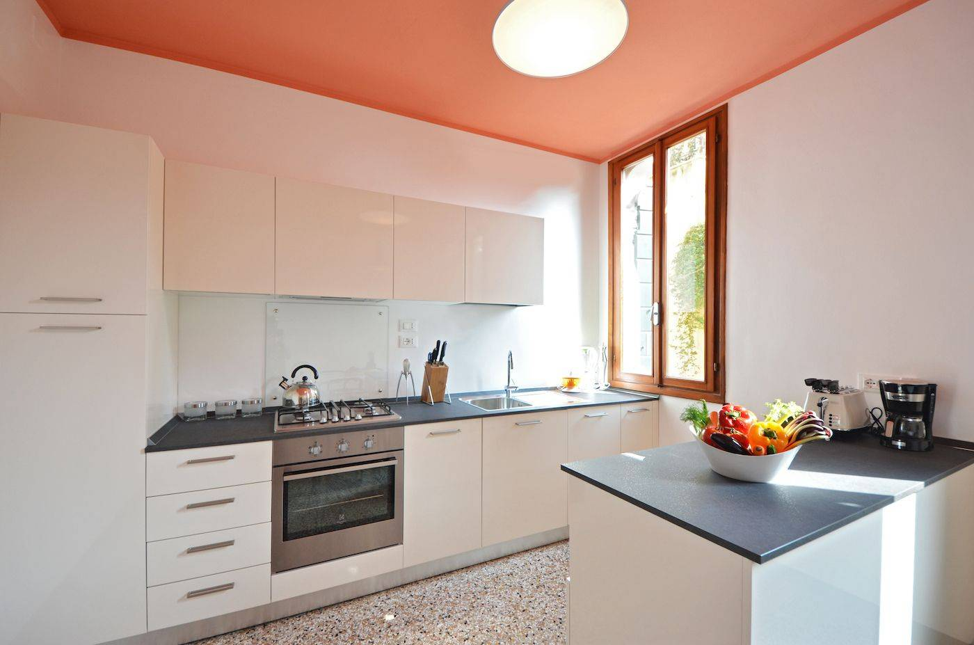 spacious dining room with very functional kitchen and view on gardens