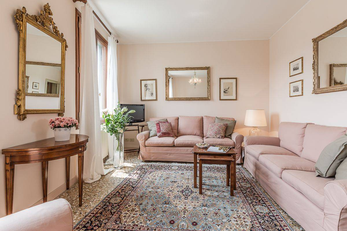 classic and elegant living room with plenty of sitting space