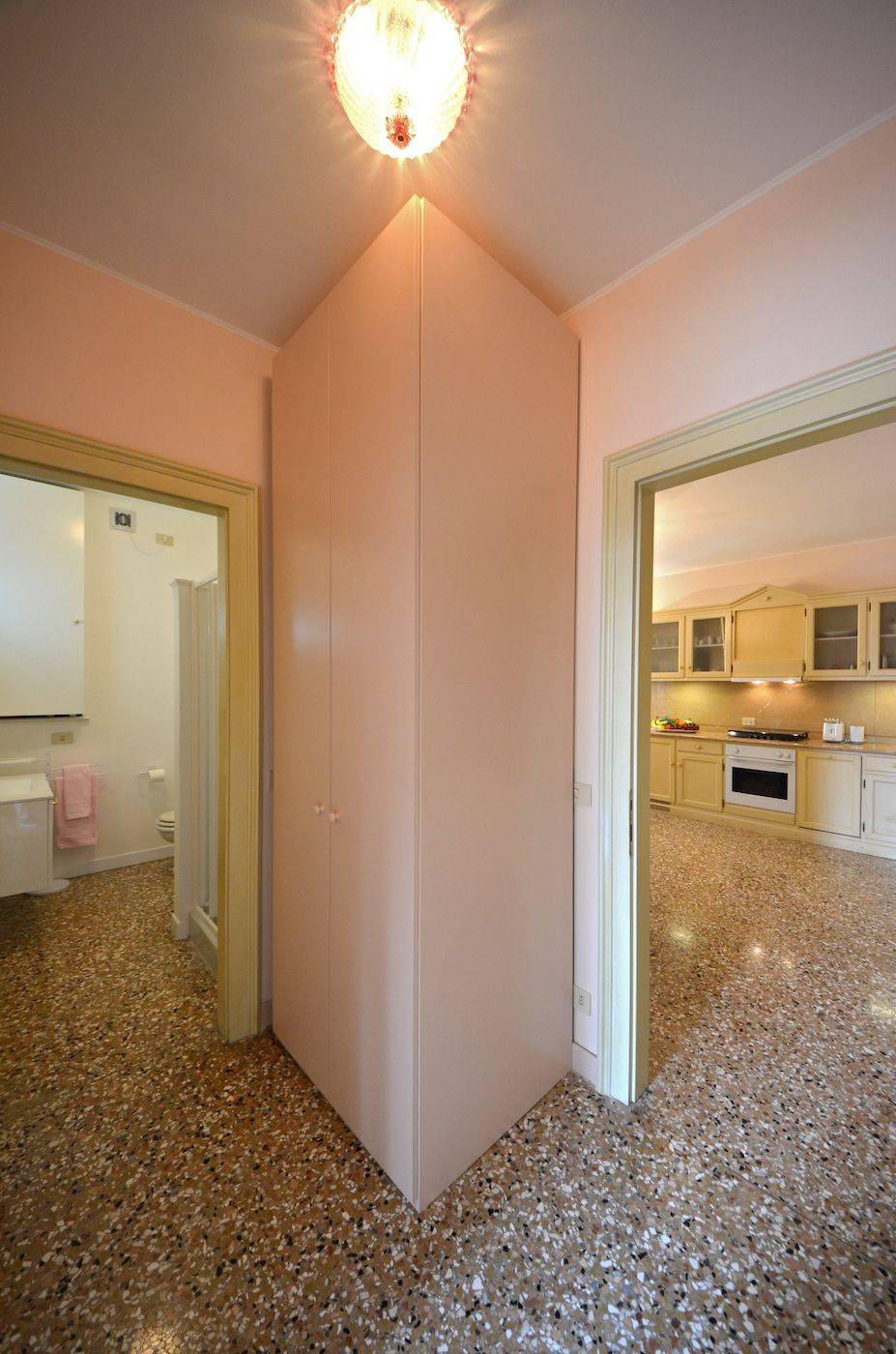 between the dining room and the bathroom there is a big closet with washing machine and dryer