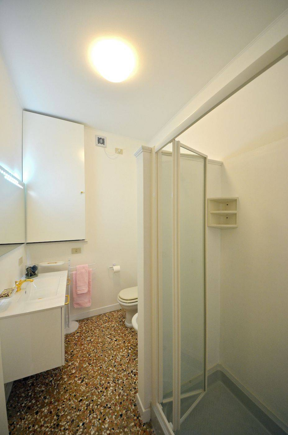 the newly renovated bathroom has a shower cabin