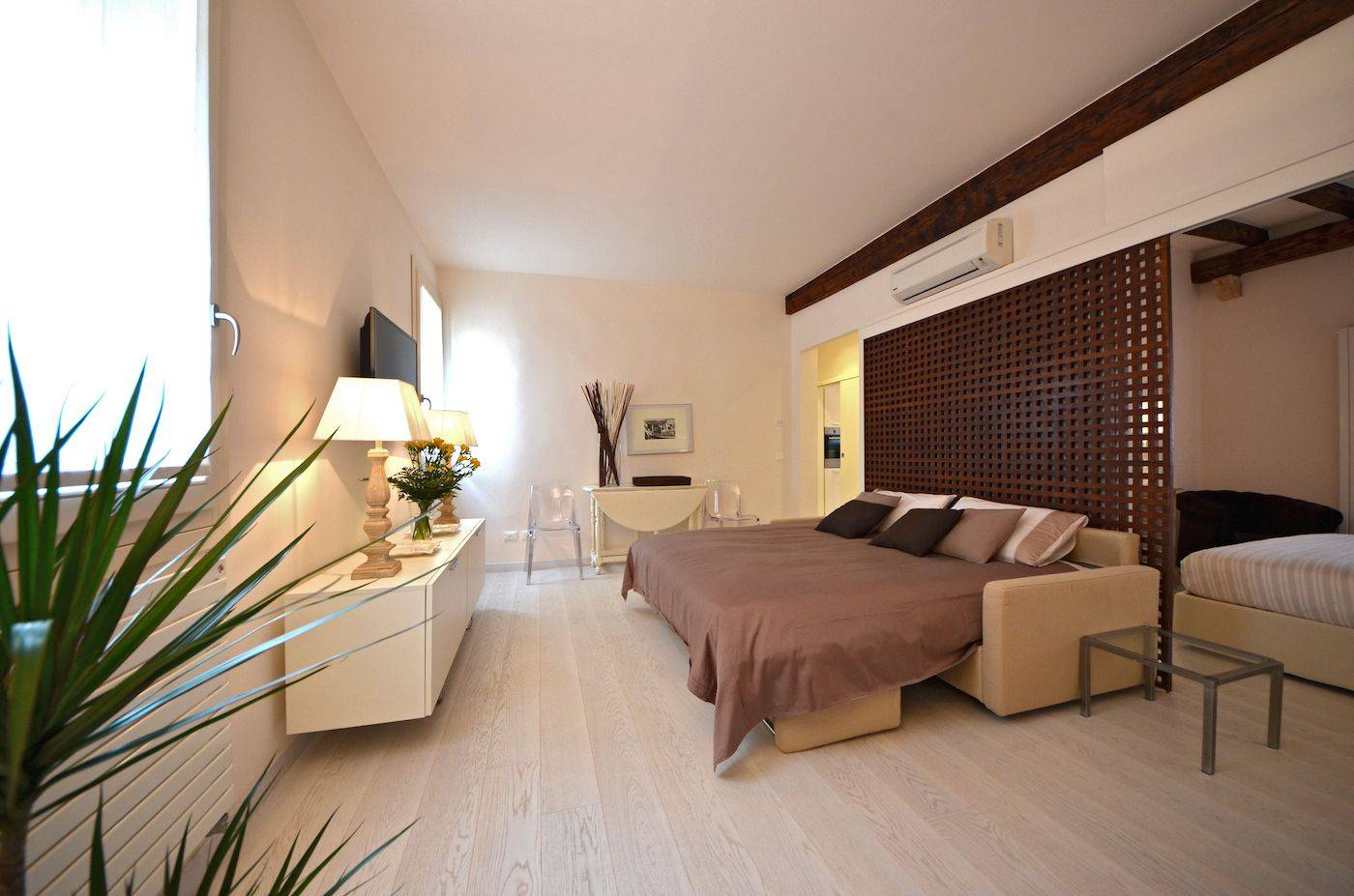 the sofa in the living room can be used as a very comfortable double bed