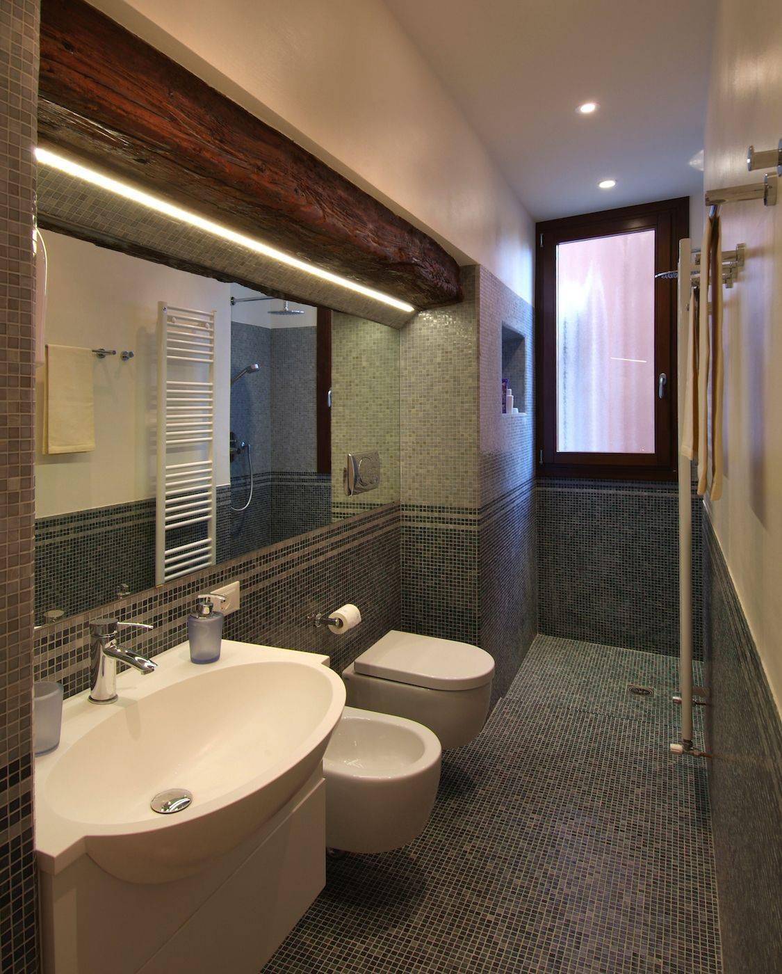 stylish and spacious bathroom with big shower