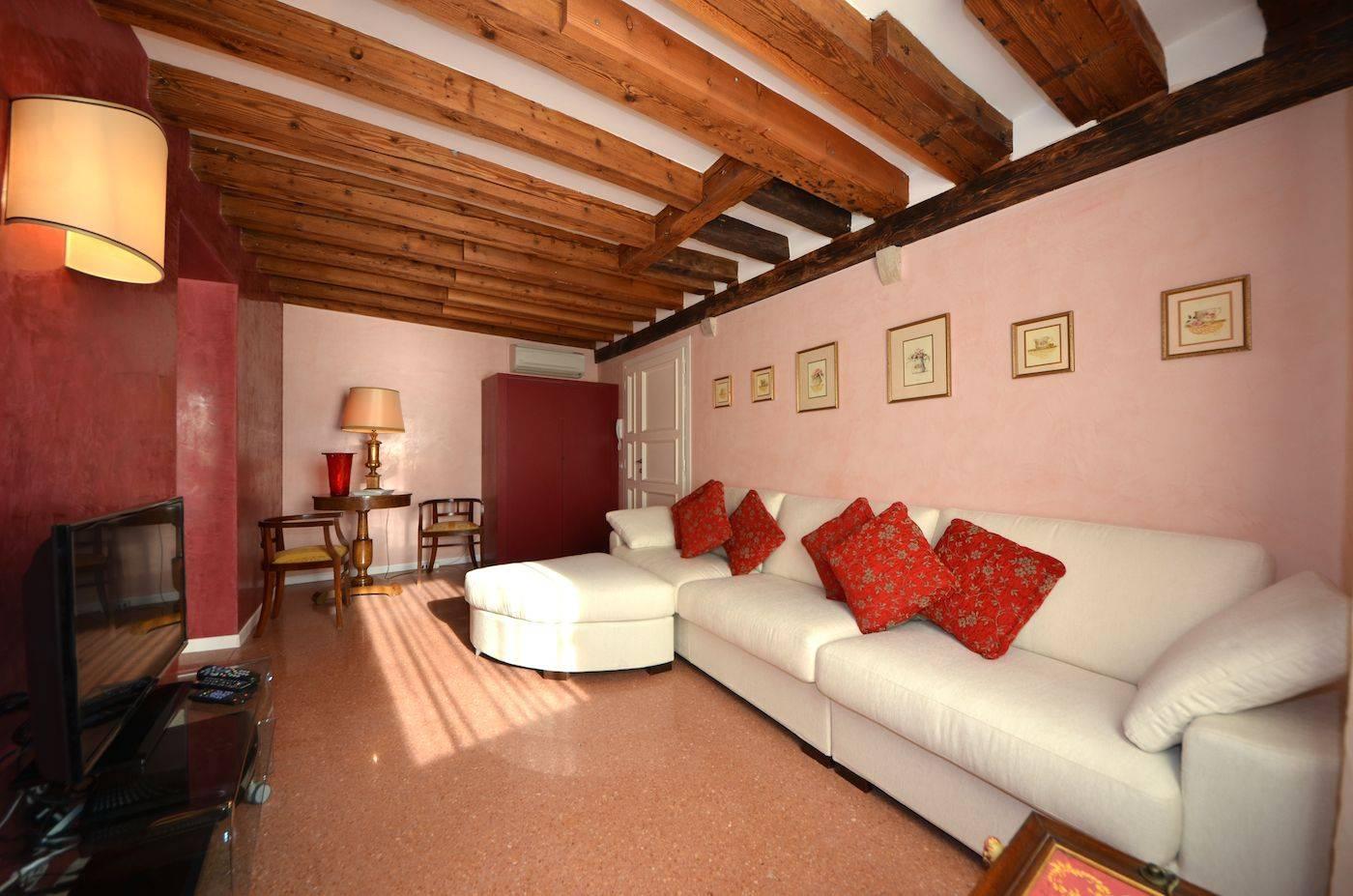 terrazzo veneziano flooring, stucco veneziano paint and wood-beamed ceilings