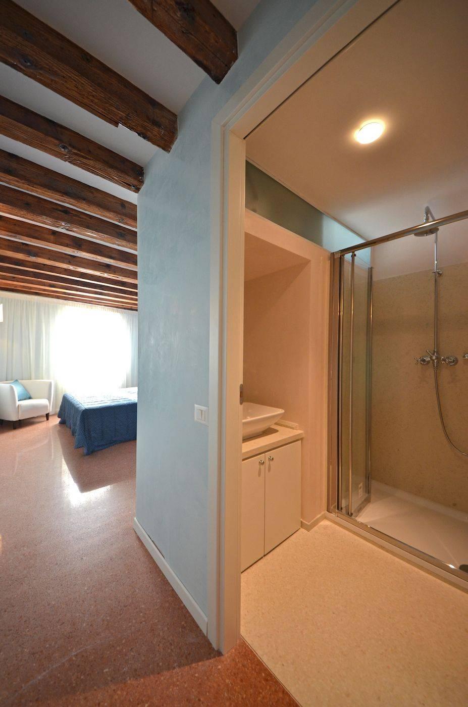 sunny master bedroom with en-suite bathroom