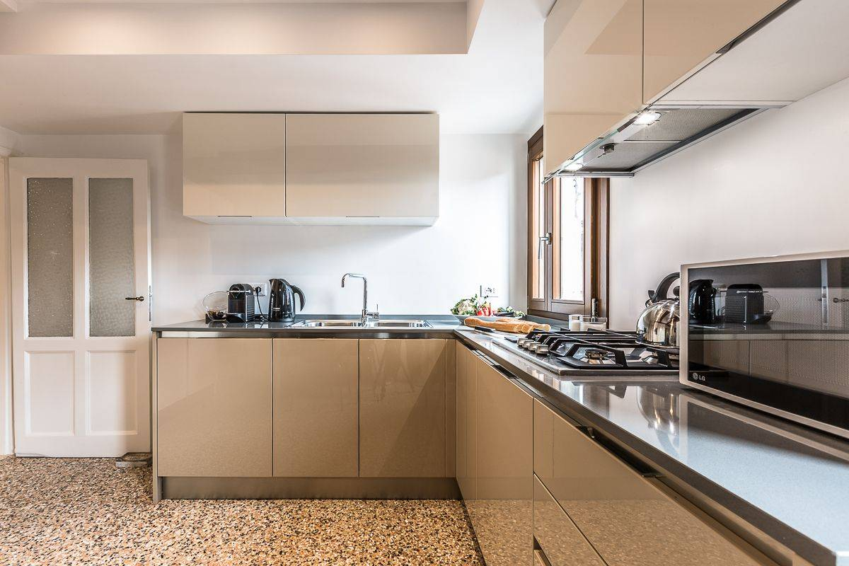 the kitchen is completely equipped with appliances and tools for cooking