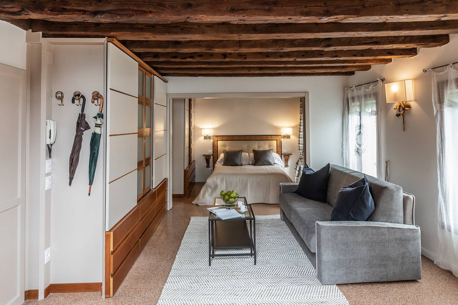 the antique wooden beams and the Terrazzo Veneziano flooring are authentic