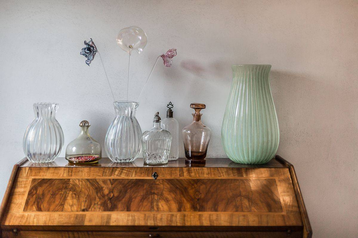 the apartment is finely furnished with Murano glass objects