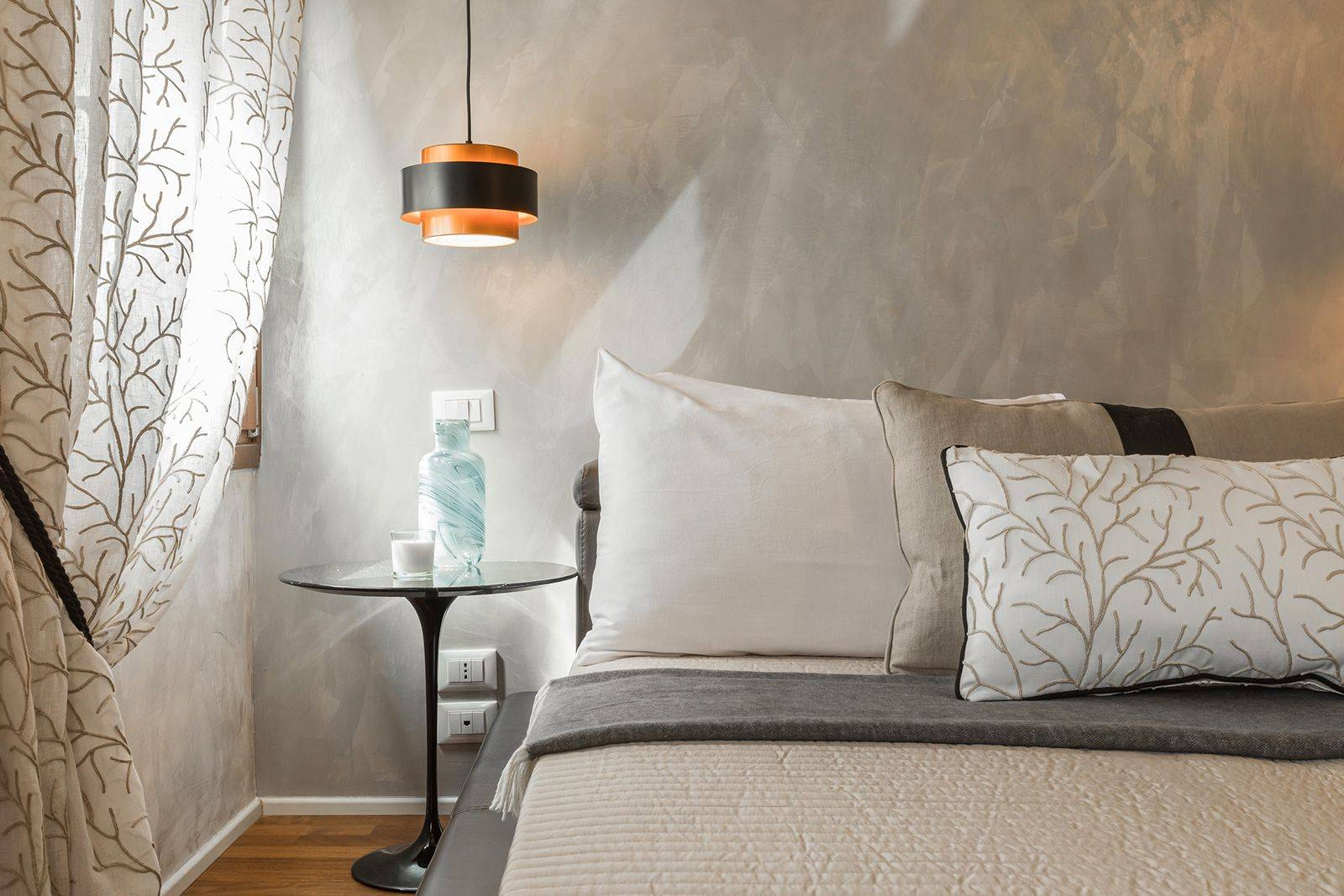 with nice fabrics and stucco Veneziano walls