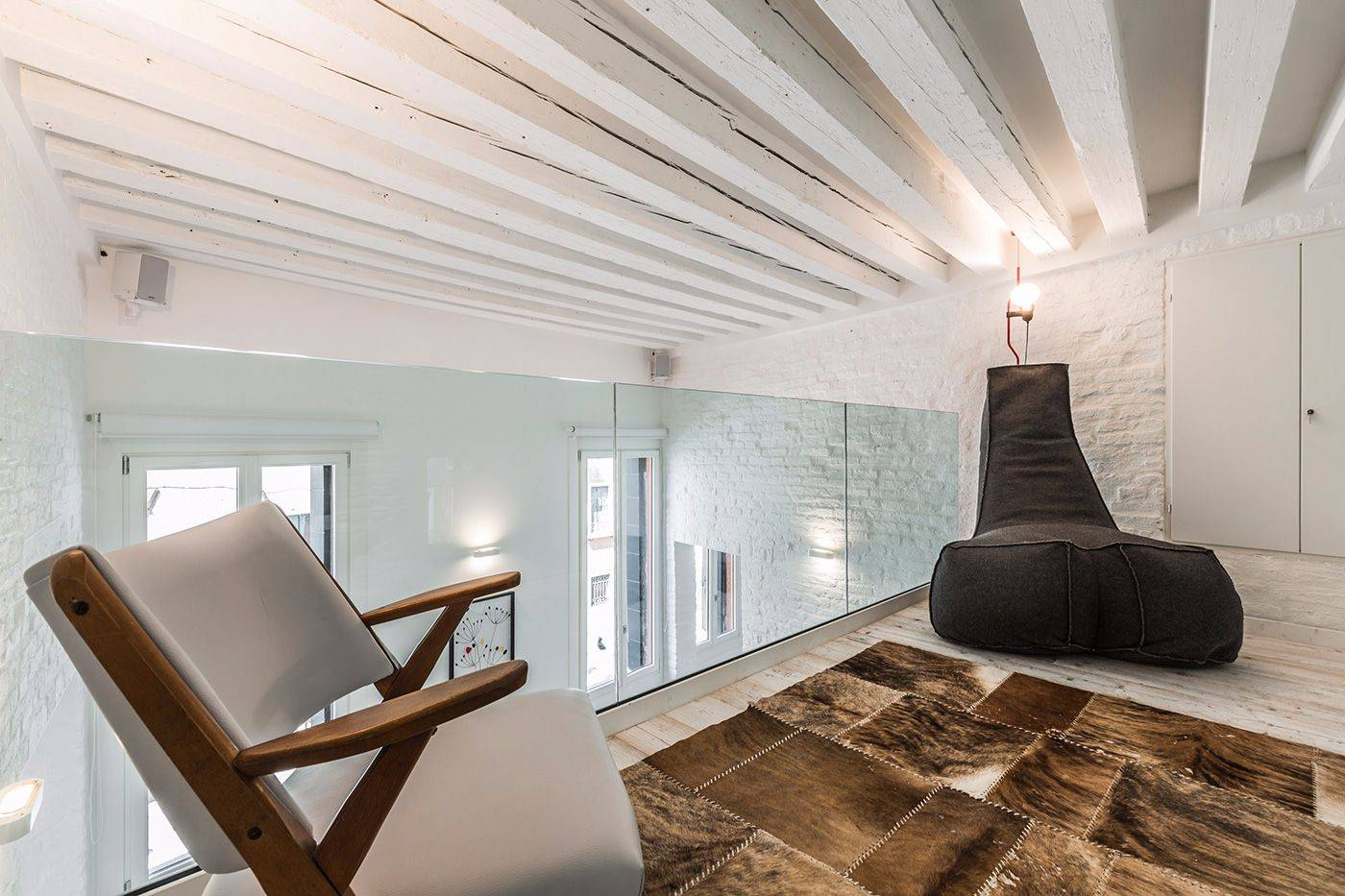 cozy mezzanine with view over the living room