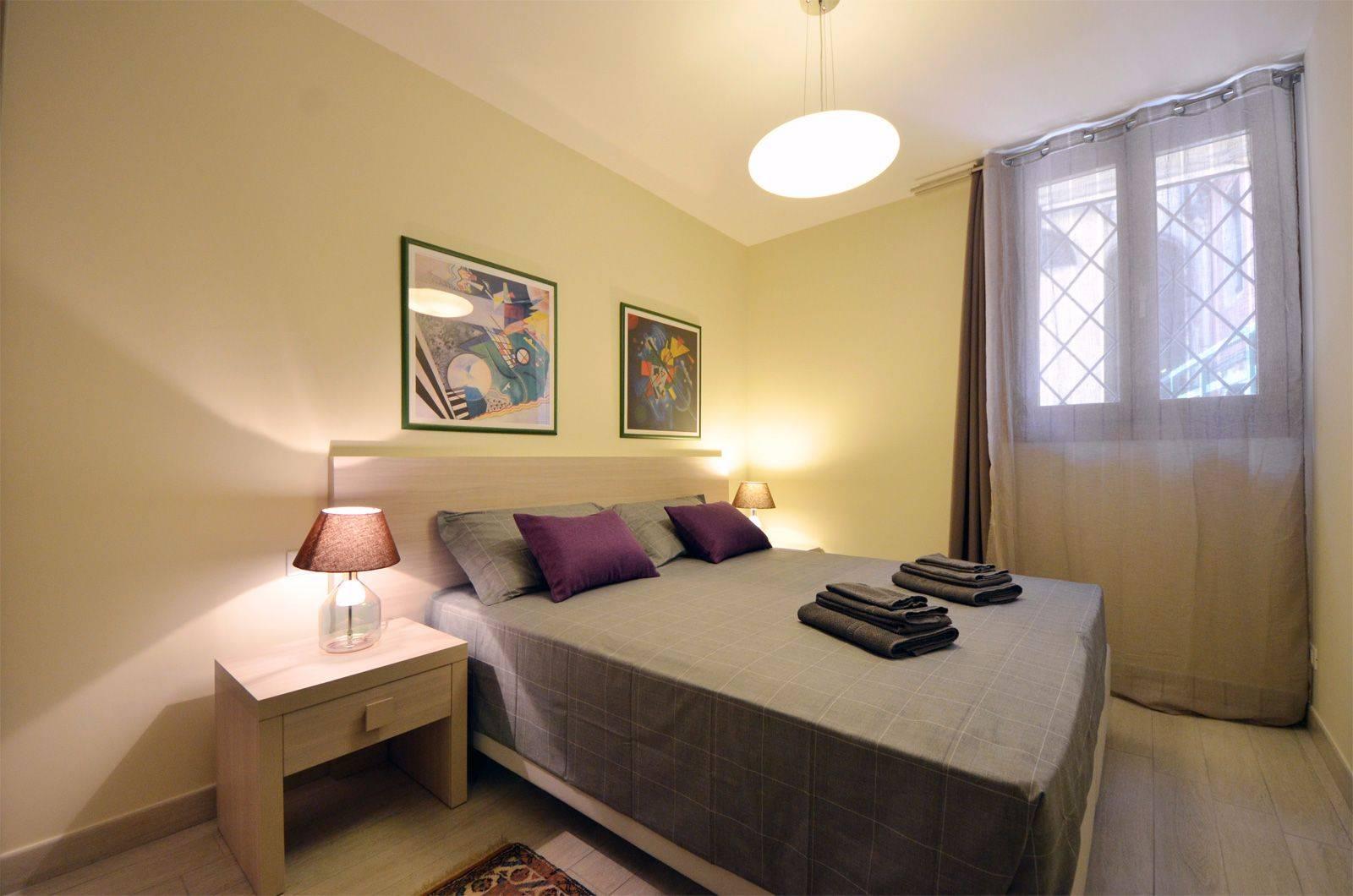 double bedroom of the Cà Pesaro Suite