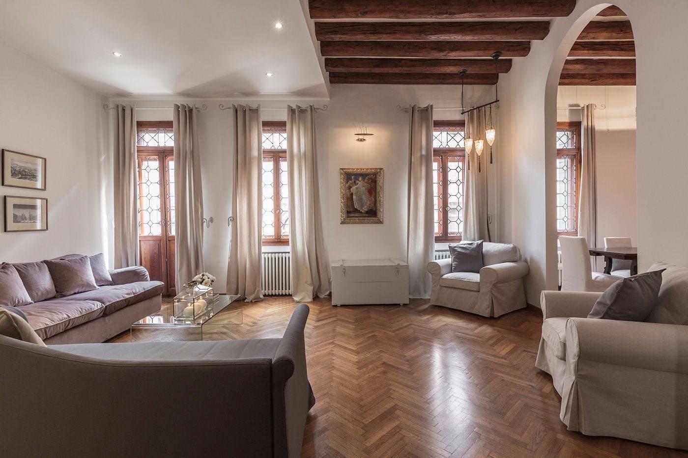 fishbone parquet flooring, antique wooden beams, leaded glass windows...