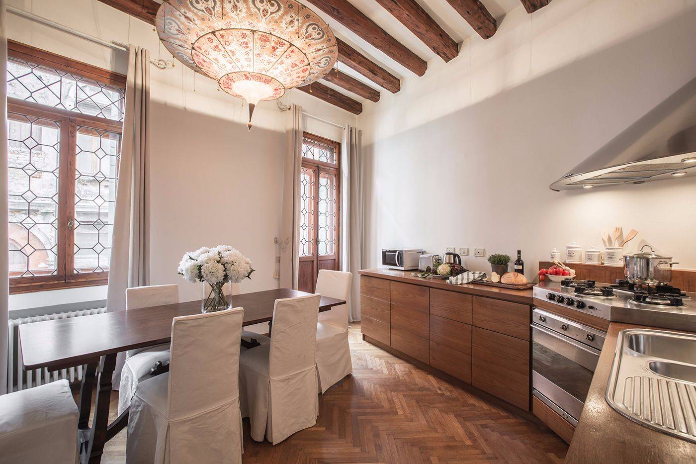 beautiful tailor made wooden kitchen with table for 6 people