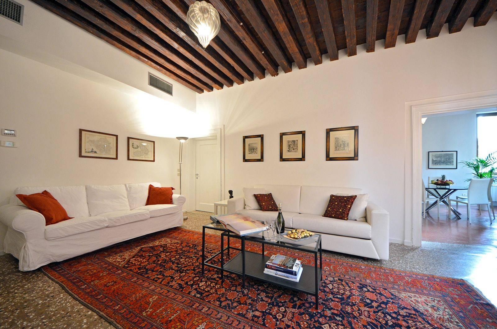 the house has terrazzo Venezian flooring and original woodem beamed ceilings