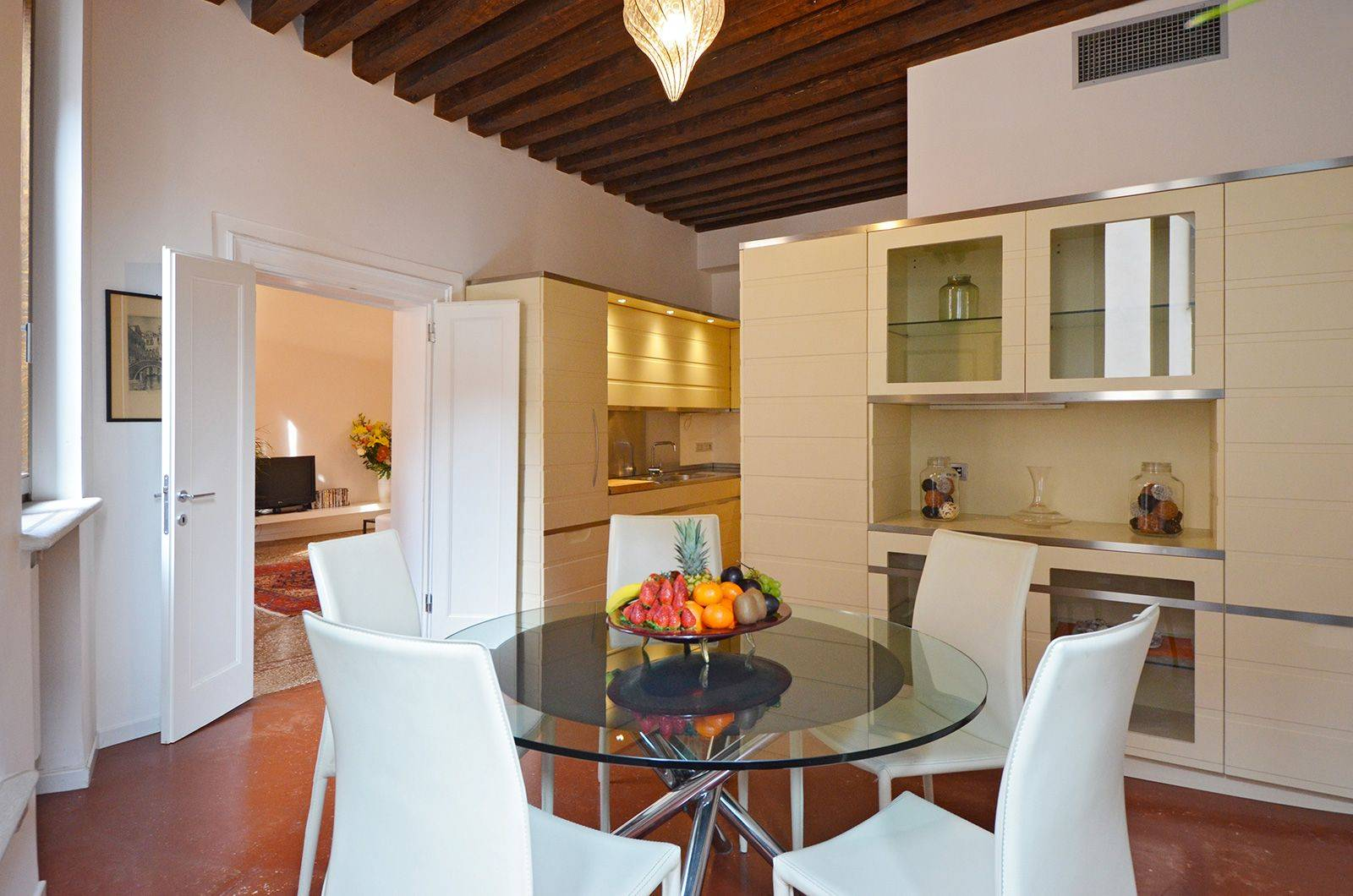the apartment is bright and airy, with high ceilings and many windows