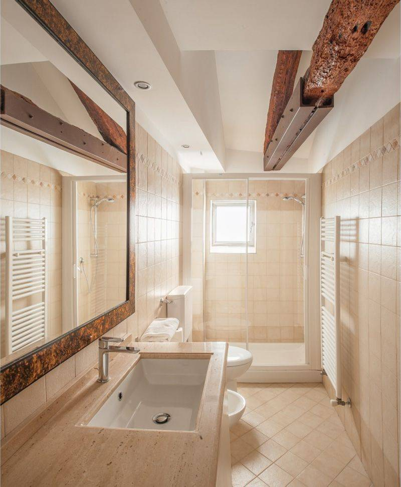 bathroom at the lower level with large shower cabin and washing machine