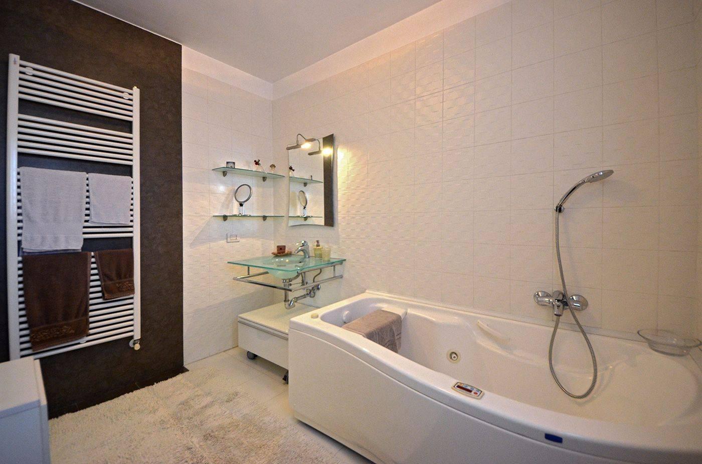 spacious master bathroom with bathtub