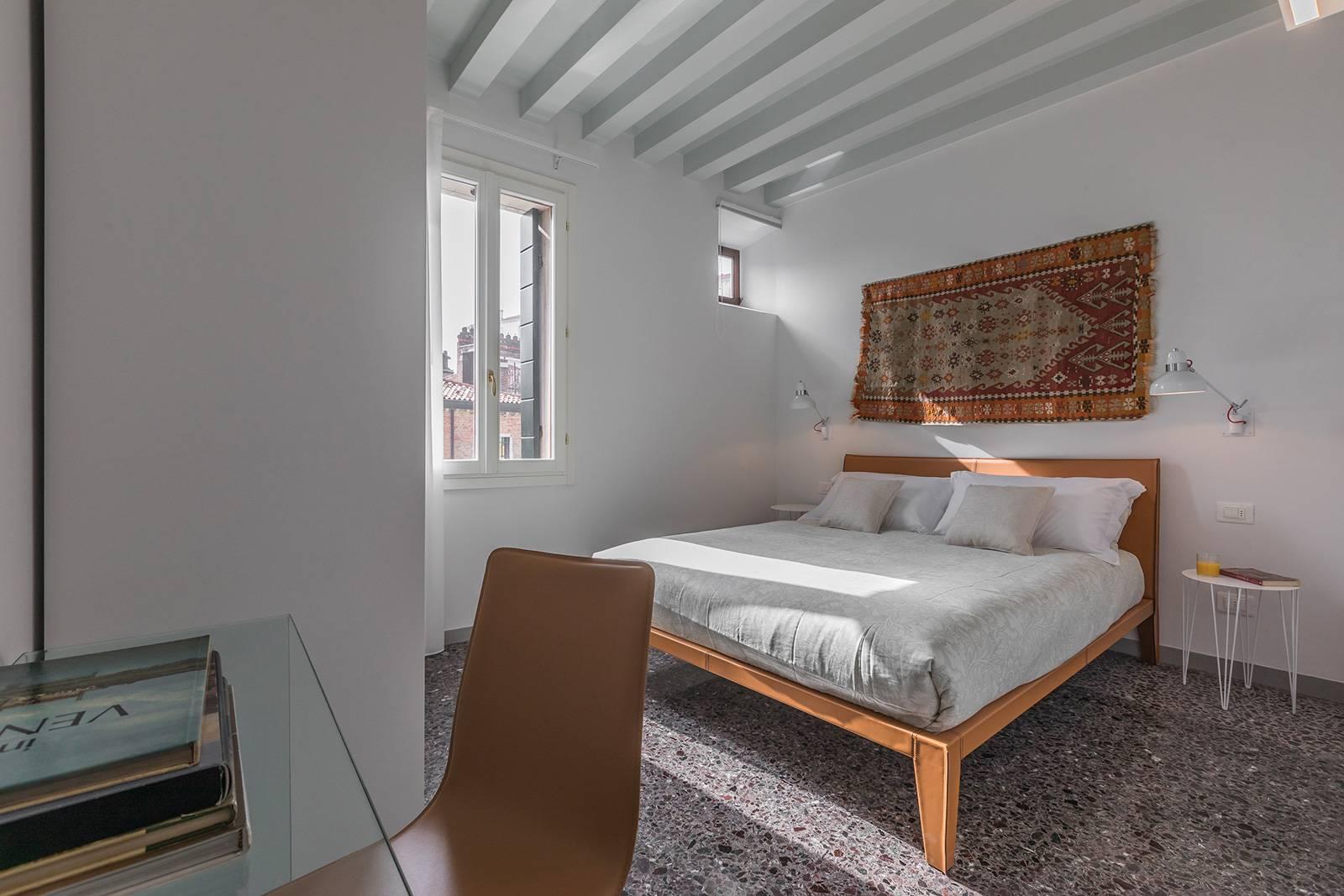 master bedroom, with wardrobe, desk and en-suite bathroom