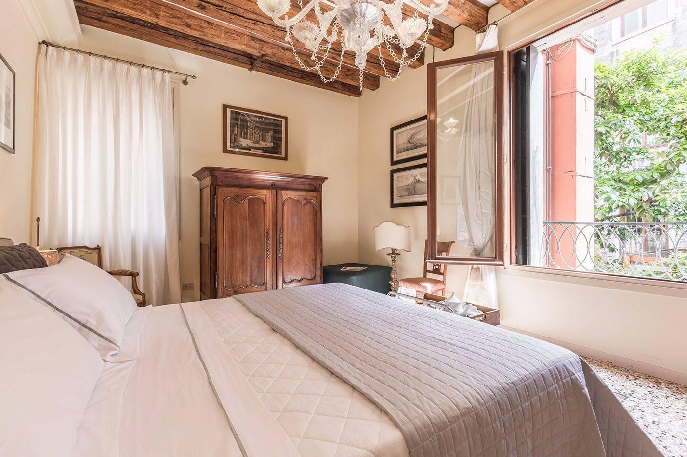 the bedroom overlooks quiet private gardens