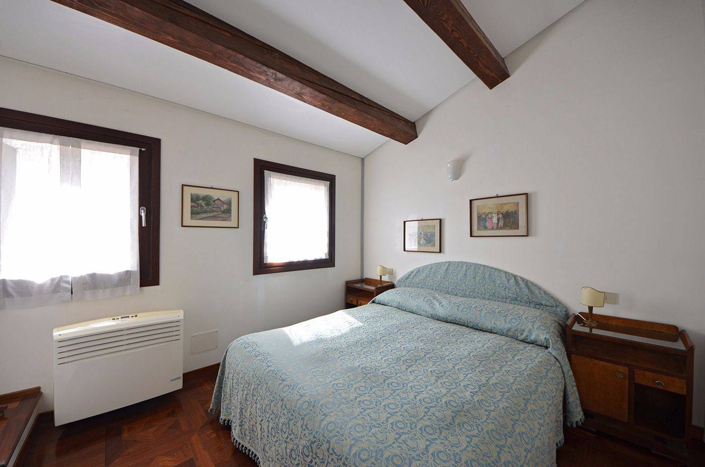 comfortable master bedroom with large wardrobe