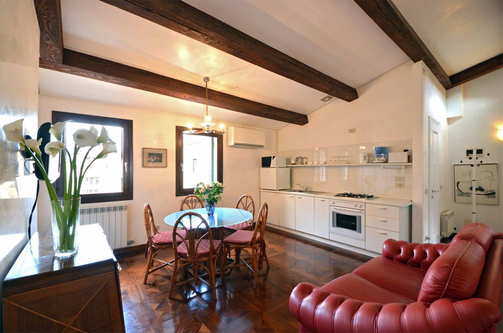 nice parquet flooring, wooden beams, interesting antiques...