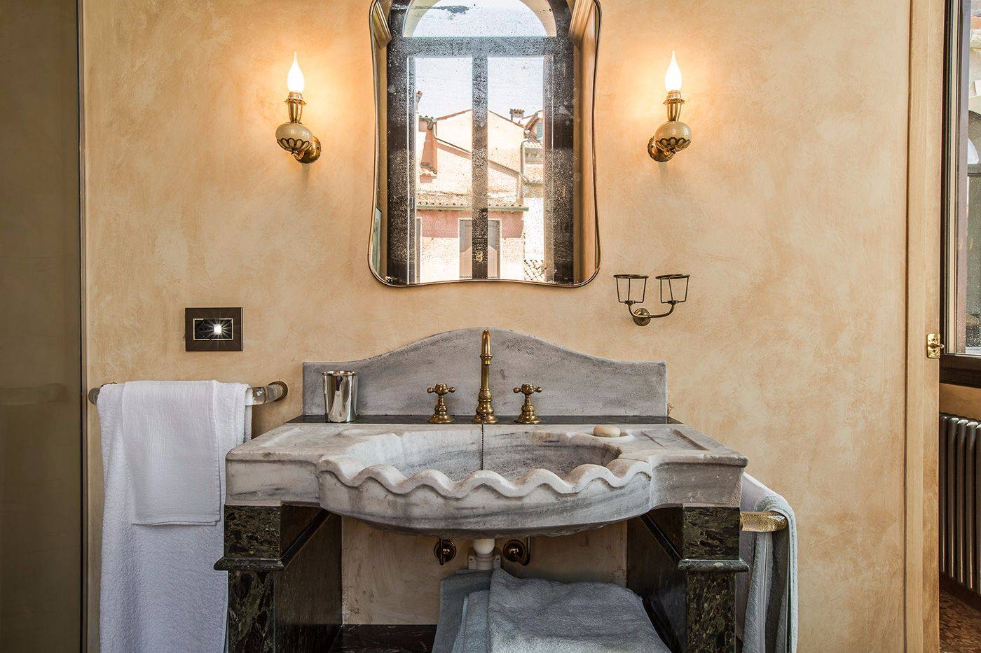 with antique stone wash-basin and large shower cabin