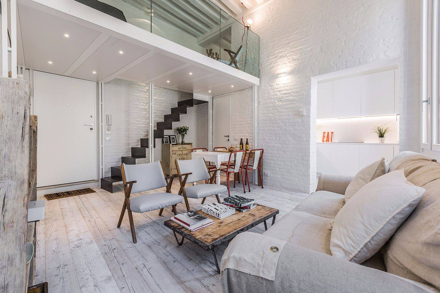 in the living room there is a mezzanine accessible through a nice metal stairway