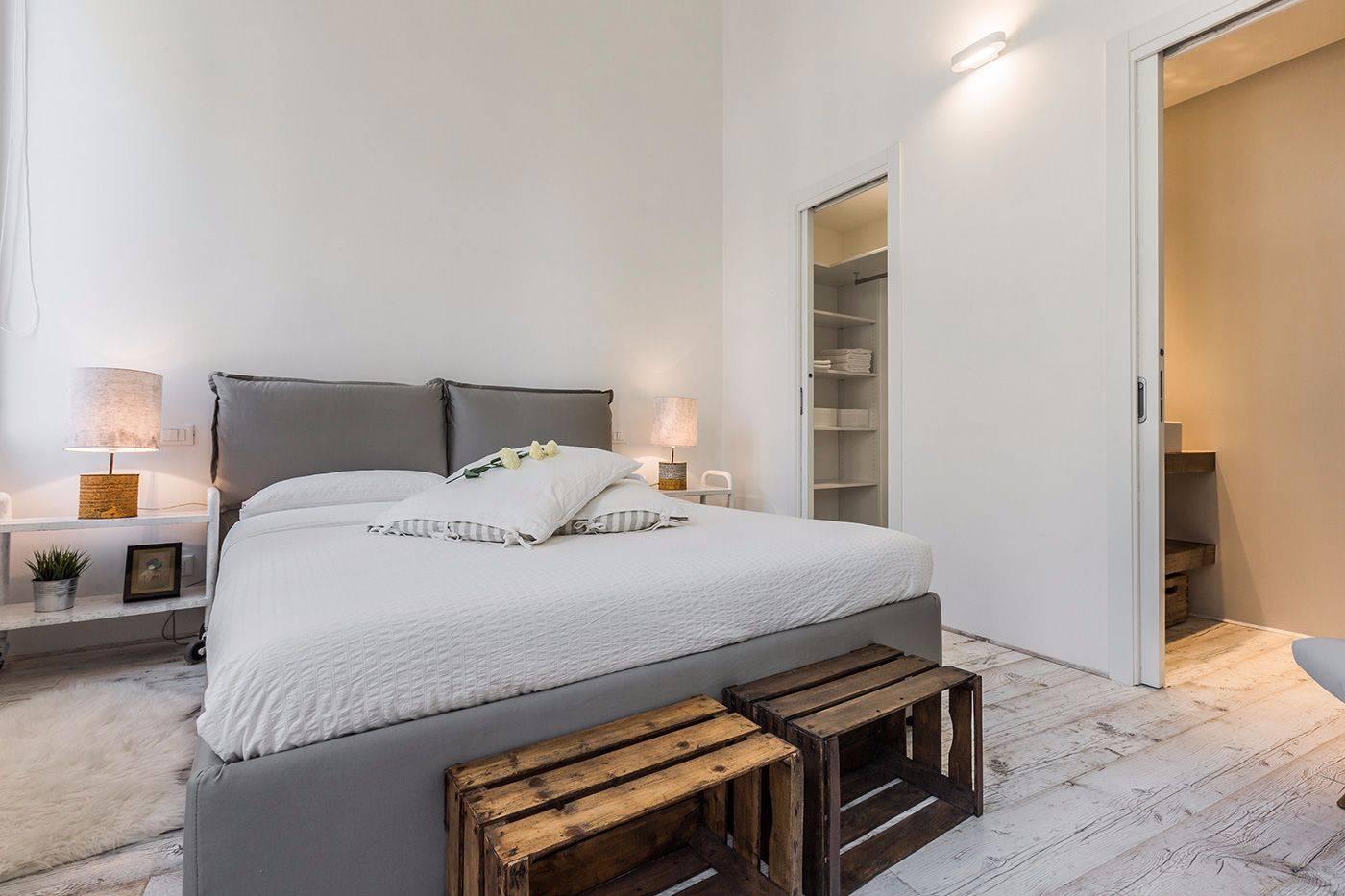 master bedroom with walk-in wardrobe and en-suite bathroom