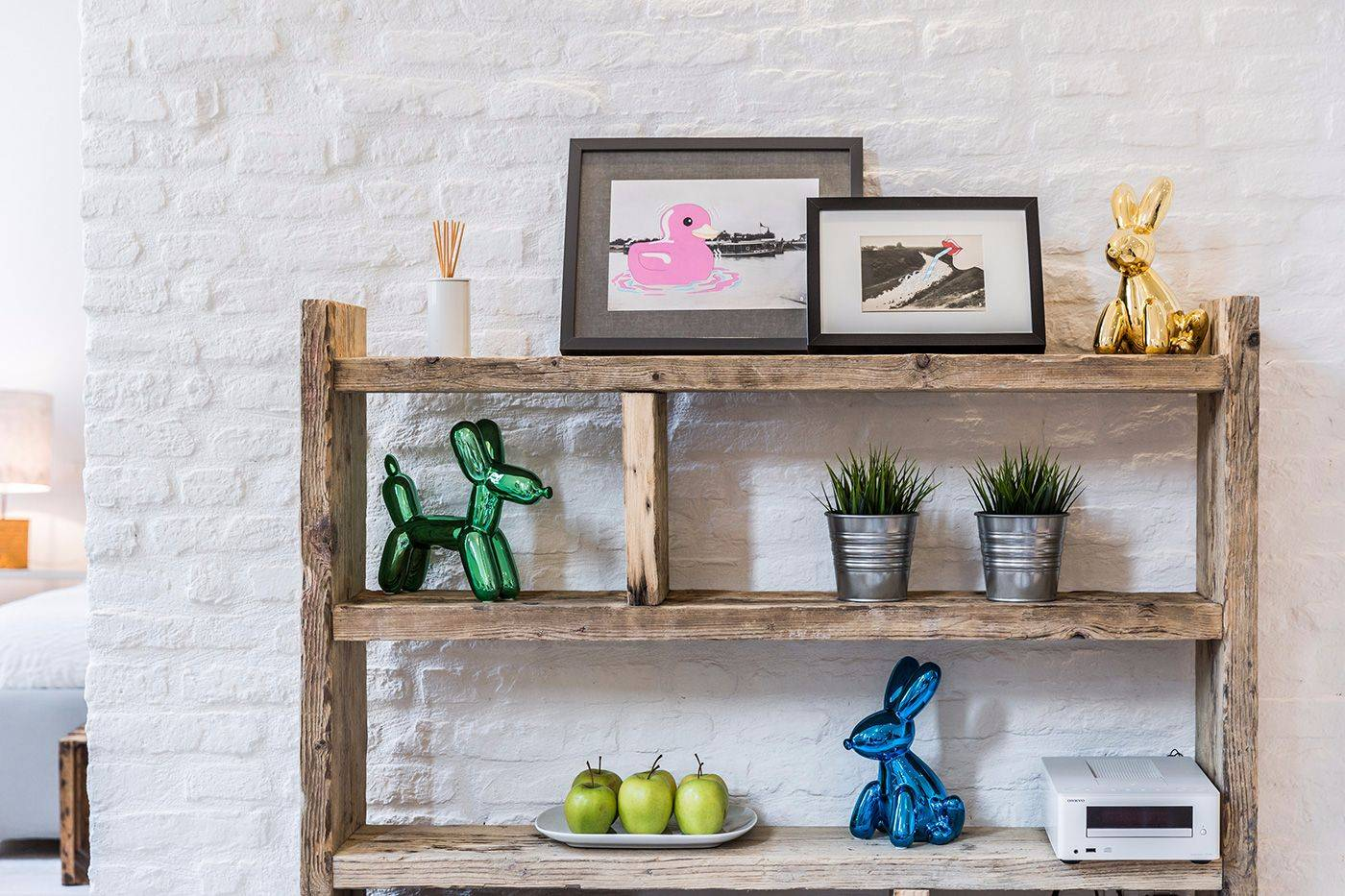 painted white brick walls enhance the colorful objects