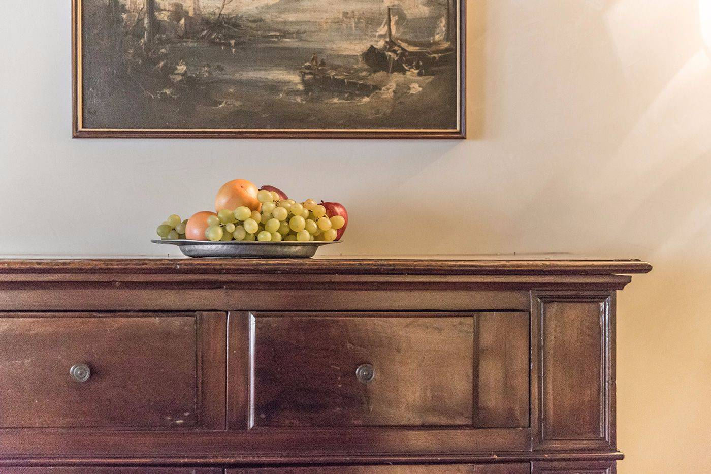 plenty of antique wood, paintings and interior details