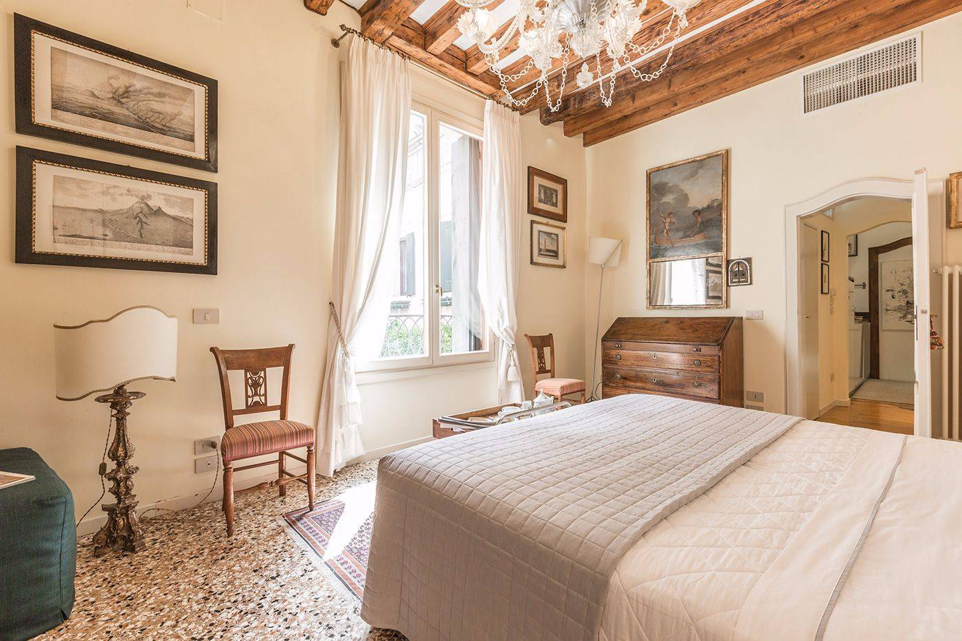very spacious master bedroom full of natural light and nicely furnished