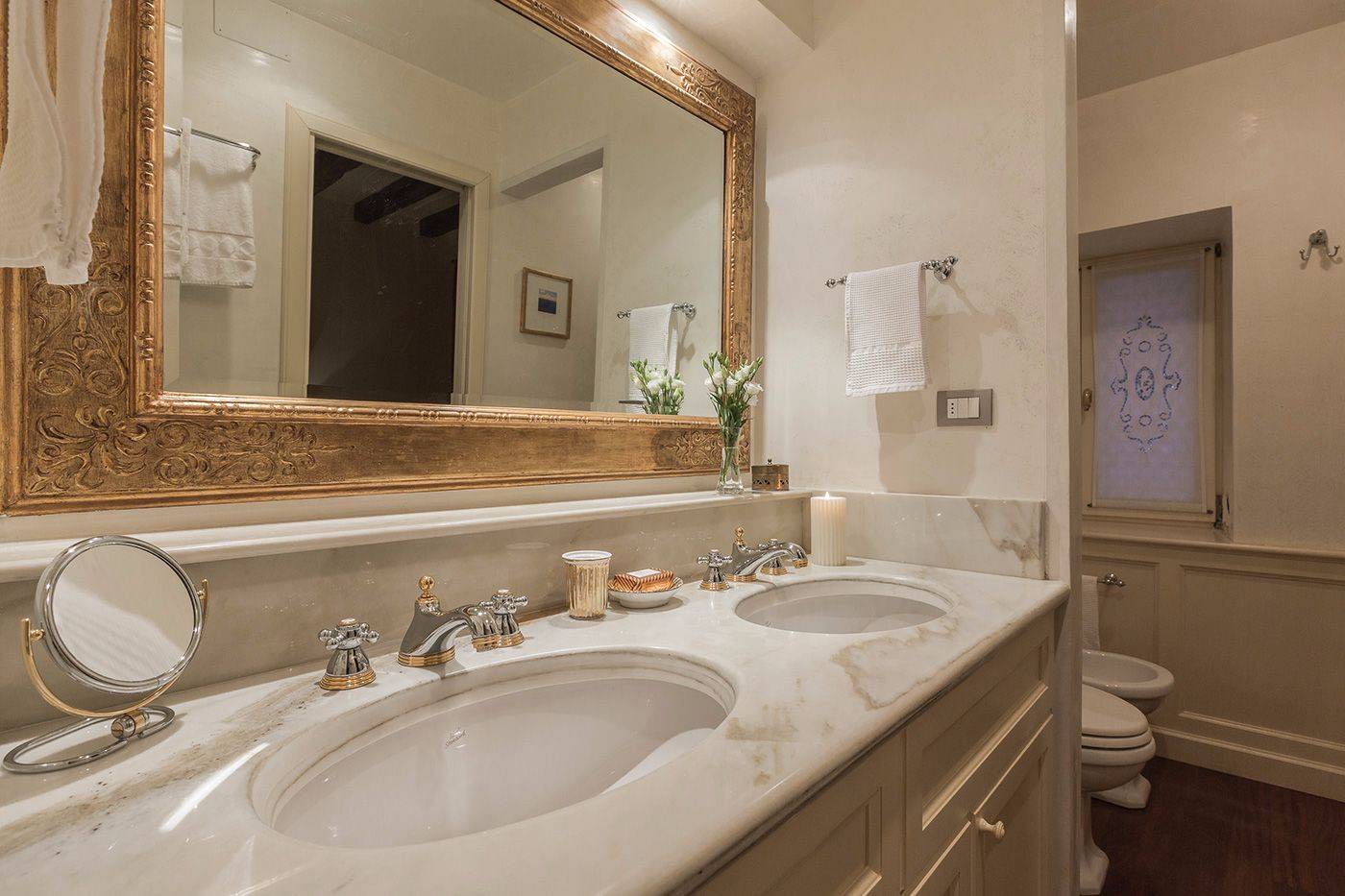 en-suite bathroom of the seconf bedroom with marble top and beautiful shower cabin