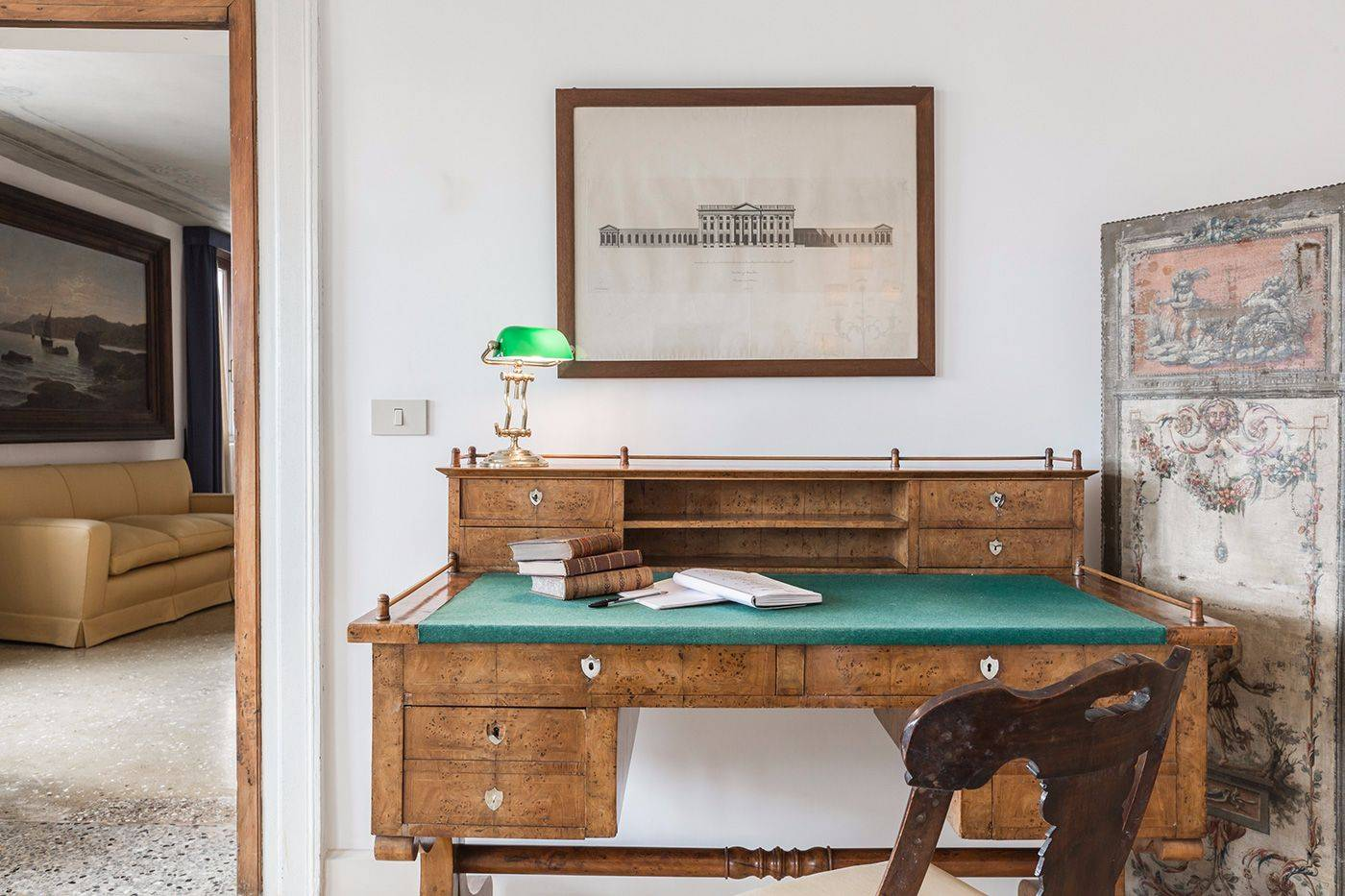 there is a nice antique desk in this room