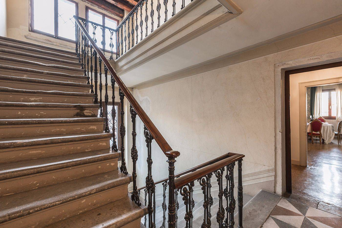 the beautiful antique stone stairway and the entrance to the Fortuny apartment