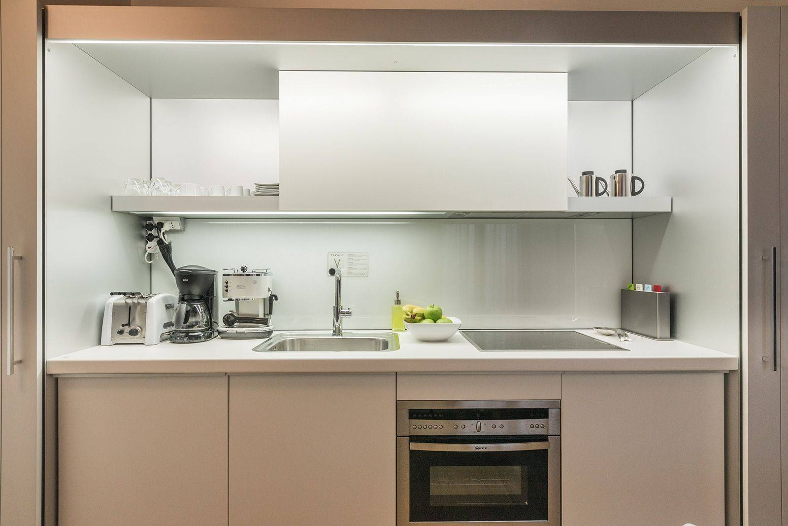 the kitchen is equipped with many useful appliances